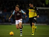 Scott Arfield of Burnley in action with George Thorne of Watford during the Sky Bet Championship match between Burnley and Watford at Turf Moor on December 03, 2013