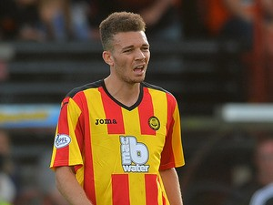 Partick's Aaron Taylor-Sinclair in action against Dundee United during their Scottish Premier League match on August 4, 2013