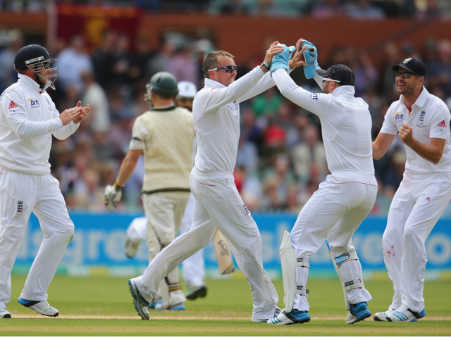 Graeme Swann of England celebrates after dismissing Chris Rogers of Australia during day one of the Second Ashes Test Match between Australia and England at Adelaide Oval on December 5, 2013