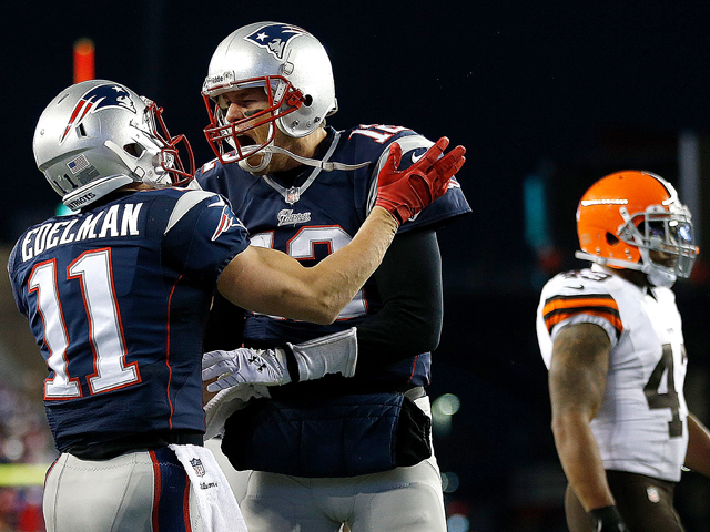 Tom Brady #12 of the New England Patriots celebrates the game-winning touchdown with Julian Edelman #11 in the 4th quarter at Gillette Stadium on December 8, 2013
