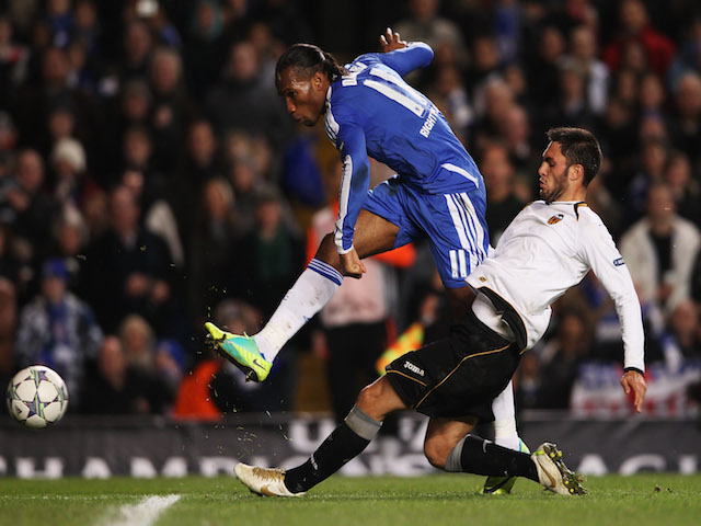 Didier Drogba of Chelsea shoots past Victor Ruiz of Valencia during the UEFA Champions League Group E match between Chelsea FC and Valencia CF at Stamford Bridge on December 6, 2011