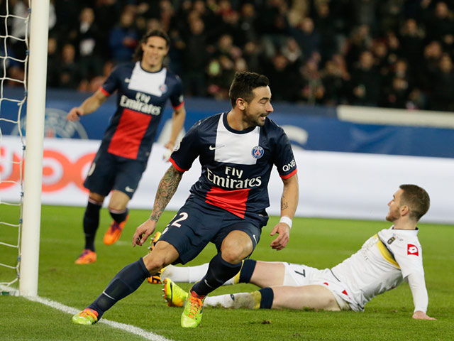 PSG's Ezequiel Lavezzi celebrates after scoring his team's second goal against Sochaux during their Ligue 1 match on December 7, 2013