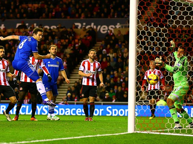 Chelsea's Frank Lampard scores his team's opening goal against Sunderland during their Premier League match on December 4, 2013