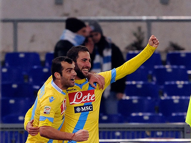 Napoli's Goran Pandev celebrates with teammate Goran Pandev after scoring his team's third goal against Lazio during their Serie A match on December 2, 2013