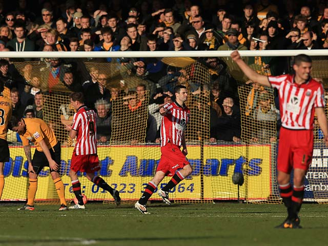 Sheffield United's Jamie Murphy celebrates after scoring his team's second goal against Cambridge during their FA Cup second round match on December 8, 2013