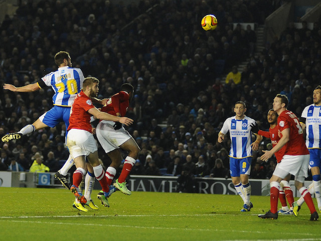 Matthew Upson scores for Brighton during the Sky Bet Championship match between Brighton & Hove Albion and Barnsley at The Amex Stadium on December 03, 2013