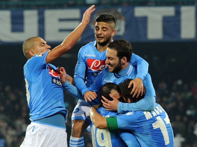 Goran Pandev of Napoli celebrates after scoring his second goal during the Serie A match between SSC Napoli and Udinese Calcio at Stadio San Paolo on December 7, 2013