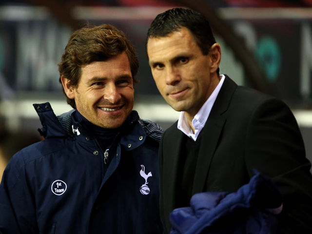Manager of Sunderland Gus Poyet and Manager of Tottenham Hotspur Andre Villas Boas share a joke during the Barclays Premier League match between Sunderland and Tottenham Hotspur at the Stadium of Light on December 7, 2013
