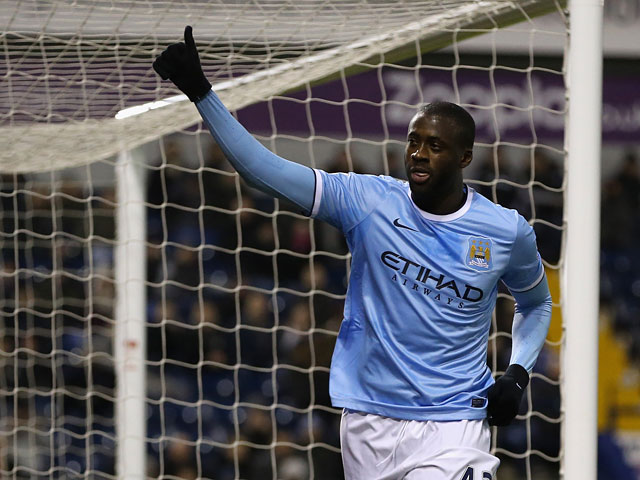 Man City's Yaya Toure celebrates after scoring his team's third goal via the penalty spot against West Brom during their Premier League match