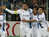 Manchester City players celebrate after Serbian defender Aleksandar Kolarov scored through a penalty kick during the UEFA Champions League group D football match against Bayern Munich on December 10, 2013