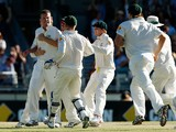 Peter Siddle of Australia is congratulated by team mates after taking the wicket of Kevin Pietersen of England during day two of the Third Ashes Test Match between Australia and England at WACA on December 14, 2013