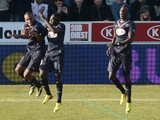Bordeaux' Jussie Ferreira Vieira celebrates with teammates after scoring during the French L1 football match Bordeaux vs Valenciennes on December 15, 2013