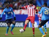 Atletico Madrid forward Diego da Silva Costa vies with Porto defenders Alex Sandro and Eliaquim Mangala on December 11, 2013