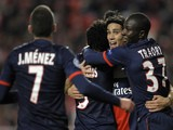 PSG's Uruguayan forward Edinson Cavani (2ndR) celebrates with teammates after scoring a goal during the UEFA Champions League Group C football match SL Benfica vs Paris Saint-Germain on December 10, 2013