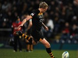 Joe Carlisle of London Wasps kicks a penalty during the Amlin Challenge Cup match between London Wasps and Grenoble at Adams Park on December 15, 2013