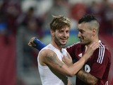 Nuremberg's defender Marvin Plattenhardt celebrates with midfielder Timo Gebhart during the German first division Bundesliga football match FC Nuernberg vs VfL Wolfsburg on November 3, 2012