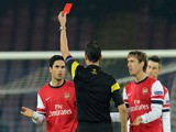 Referee Viktor Kassai shows the red card to Mikel Arteta of Arsenal during the UEFA Champions League Group F match between SSC Napoli and Arsenal on December 11, 2013