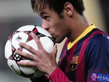 Barcelona's Brazilian forward Neymar da Silva Santos Junior kisses a ball after scoring a hat-trick during the UEFA Champions League Group H football match against Celtic on December 11, 2013