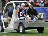 Rob Gronkowski #87 of the New England Patriots reacts to the cheers of fan as he leaves the field with an injury in the 3rd quarter against the Cleveland Browns at Gillette Stadium on December 8, 2013