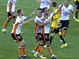 Ivan Franjic of Brisbane celebrates his goal with team mates Luke Brattan and Jack Hingert during the round 10 A-League Wellington Phoenix vs Brisbane Roar football match at the Westpac Stadium in Wellington on December 14, 2013