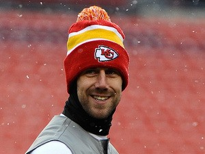 Quarterback Alex Smith of the Kansas City Chiefs warms up prior to playing an NFL game against the Washington Redskins at FedExField on December 8, 2013