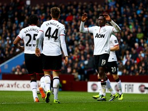 Danny Welbeck of Manchester United celebrates with team mates Luis Antonio Valencia and Adnan Januzaj as he scores their second goal during the Barclays Premier League match between Aston Villa and Manchester United at Villa Park on December 15, 2013