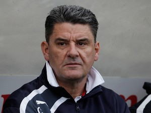 Crawley Town manager John Gregory looks on prior to kick off during the FA Cup Second Round match between Bristol Rovers on December 7, 2013