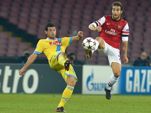 Arsenal's French midfielder Mathieu Flamini vies with Napoli's Swiss midfielder Blerim Dzemaili (L) during the UEFA Champions League group F football match on December 11, 2013