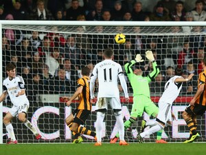 Chico Flores of Swansea City scores his sides equalising goal during the Barclays Premier League match between Swansea City and Hull City at the Liberty Stadium on December 9, 2013