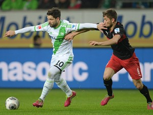Stuttgart's midfielder Moritz Leitner and Wolfsburg's Brazilian midfielder Diego vie for the ball during the German first division Bundesliga football match VfL Wolfsburg vs VfB Stuttgart in the German city of Wolfsburg on December 14, 2013