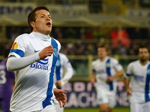 Dnipro's Yevhen Konoplyanka celebrates after scoring the opening goal against Fiorentina during their Europa League group match on December 12, 2013