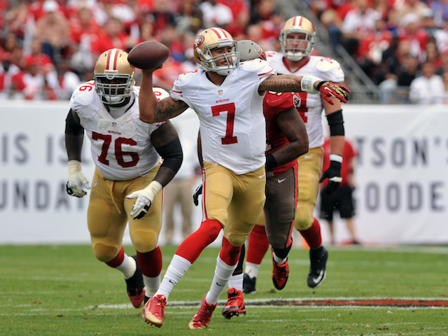 Quarterback Colin Kaepernick of the San Francisco 49ers looks to pass against the Tampa Bay Buccaneers December 15, 2013