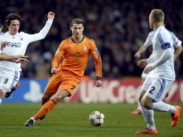 Thomas Delaney of FC Copenhagen and Cristiano Ronaldo of Real Madrid vie for the ball during the UEFA Champions League group B football match FC Copenhagen v Real Madrid CF on December 10, 2013