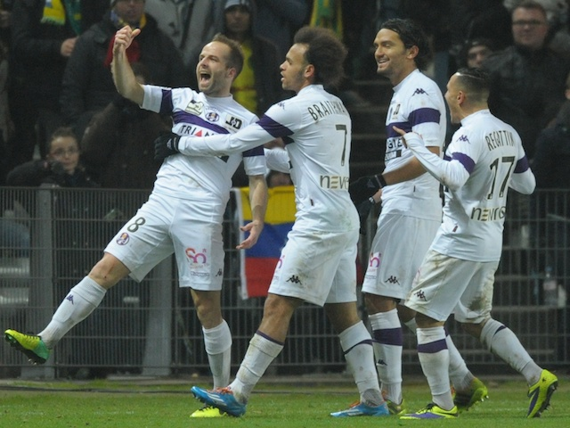Toulouse's French midfielder Etienne Didot celebrates with teammates after scoring a goal during the French L1 football match between Nantes and Toulouse on December 14, 2013