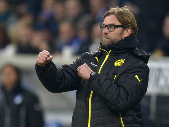 Dortmund's head coach Jurgen Klopp reacts as his team scores its 2nd goal during the German first division Bundesliga football match 1899 Hoffenheim vs Borussia Dortmund in Sinsheim, southwestern Germany, on December 14, 2013