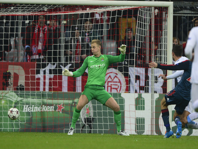 Manchester City's Joe Hart fails to save Bayern Munich's midfielder Thomas Mueller's goal during the UEFA Champions League group D football match on December 10, 2013