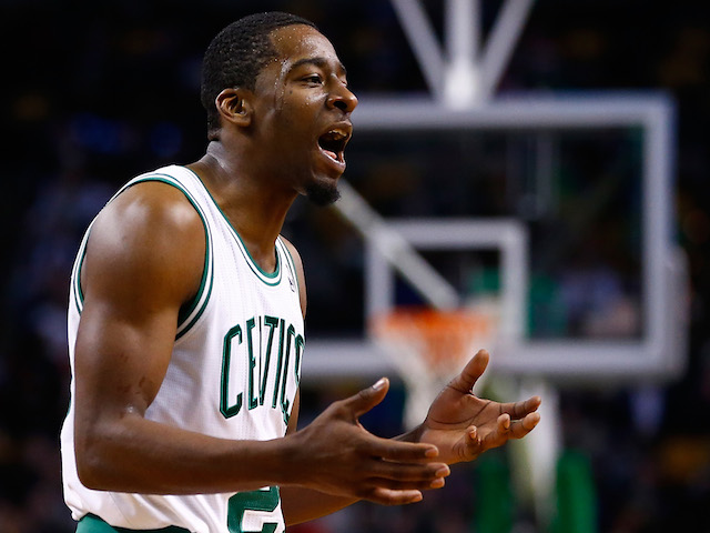 Jordan Crawford of the Boston Celtics argues with a referee in the second half against the Los Angeles Clippers during the game at TD Garden on December 11, 2013