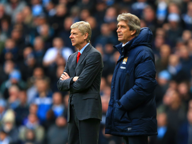 Arsene Wenger manager of Arsenal and Manuel Pellegrini manager of Manchester City look on during the Barclays Premier League match between Manchester City and Arsenal at Etihad Stadium on December 14, 2013
