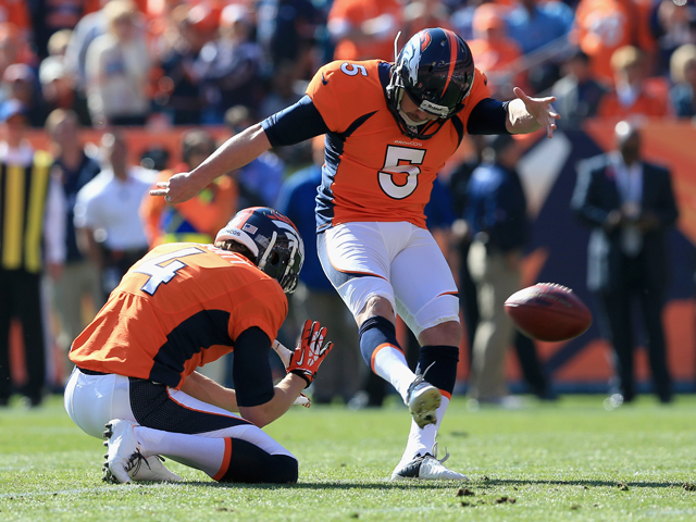 Matt Prater #5 of the Denver Broncos kicks an extra point from the hold of punter Britton Colquitt #4 of the Denver Broncos against the Jacksonville Jaguars at Sports Authority Field at Mile High on October 13, 2013