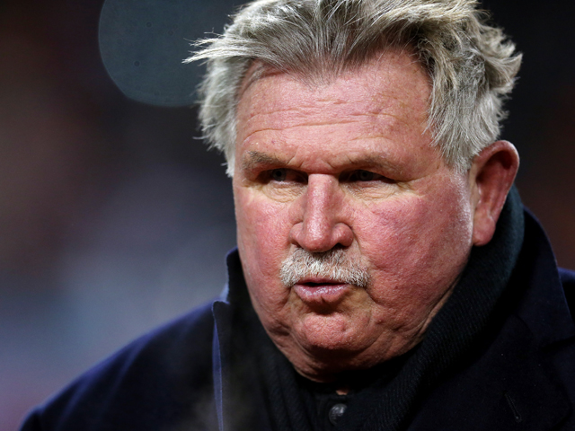 Former Chicago Bears player and coach, Mike Ditka, walks off the field following a ceremony retiring his number during halftime of a game between the Chicago Bears and the Dallas Cowboys at Soldier Field on December 9, 2013