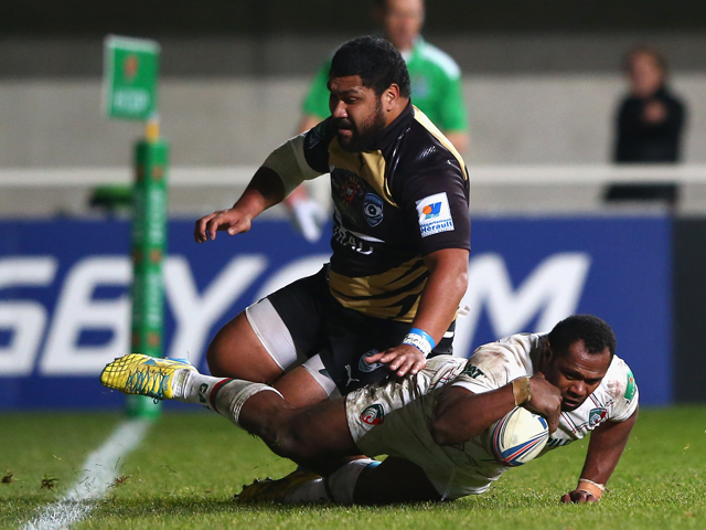 Niki Goneva of Leicester Tigers scores a last minute winning try as Paea Fa'anunu of Montpellier challenges during the Heineken Cup Pool 5 match between Montpellier and Leicester Tigers at Stade Yves Du Manoir on December 15, 2013
