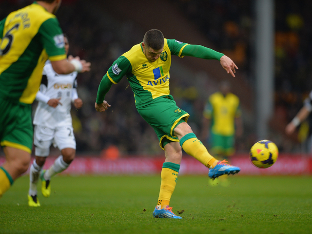 Gary Hooper of Norwich scores their fisrt goal during the Barclays Premier League match between Norwich City and Swansea City at Carrow Road on December 15, 2013