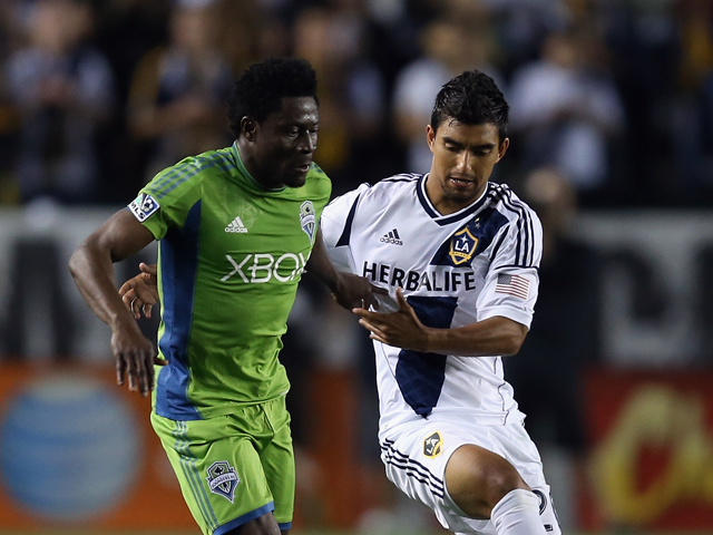 Obafemi Martins #9 of Seattle Sounders FC and A.J. DeLaGarza #20 of Los Angeles Galaxy fight for the ball in the second half at The Home Depot Center on May 26, 2013