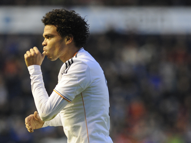 Real Madrid's Portuguese defender Pepe celebrates his team's second goal during the Spanish league football match Osasuna vs Real Madrid at the Reyno de Navarra in Pamplona on December 14, 2013