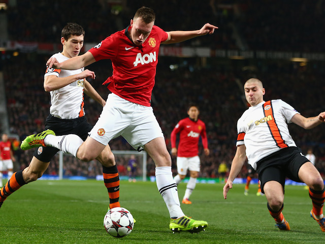 Phil Jones of Manchester United crosses the ball during the UEFA Champions League Group A match between Manchester United and Shakhtar Donetsk at Old Trafford on December 10, 2013