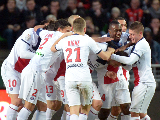 Paris Saint Germain's players jubilate after scoring a goal during the French L1 football match Rennes against Paris Saint Germain on December 14, 2013