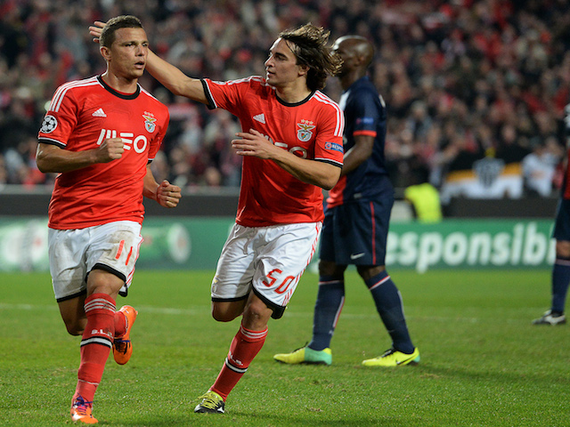 Benfica's Brazilian forward Rodrigo Lima (L) celebrates after scoring a goal on a penalty kick during the UEFA Champions League Group C football match