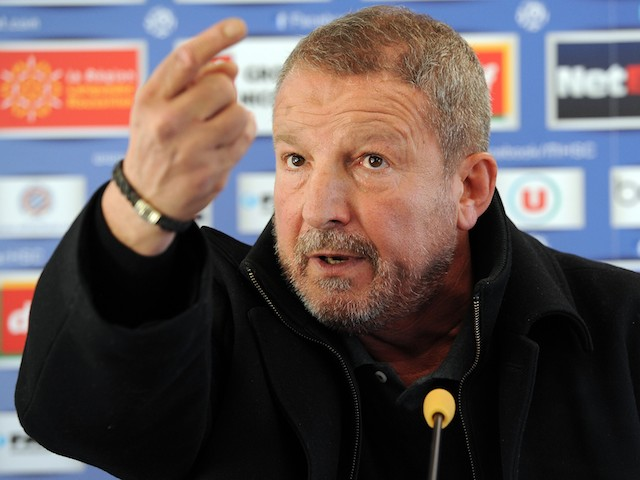 New coach of the French L1 football club of Montpellier (MHSC) Rolland Courbis gestures during a press conference on December 9, 2013