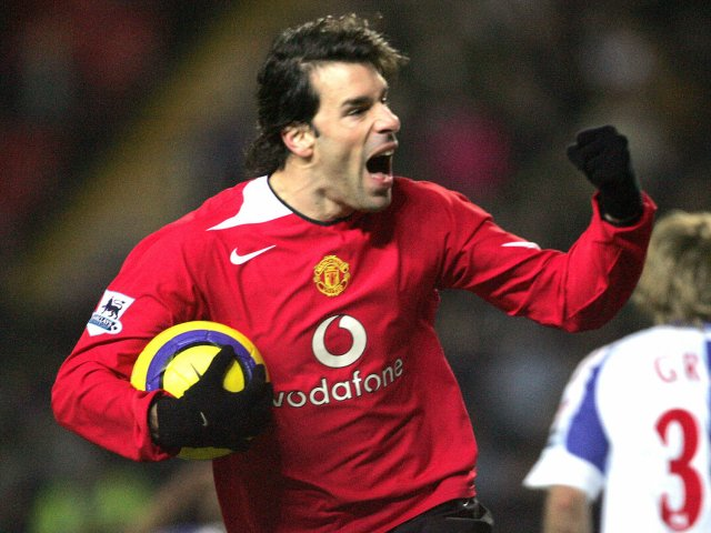 Ruud van Nistelrooy celebrates scoring for Manchester United against Blackburn Rovers on February 01, 2005.