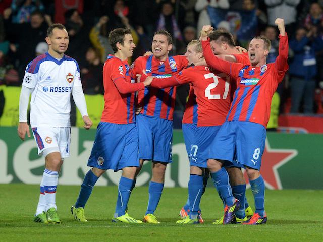 Plzen's players celebrate after the UEFA Champions League group D match Viktoria Plzen vs CSKA Moscow in Pilsen, Czech Republic on December 10, 2013